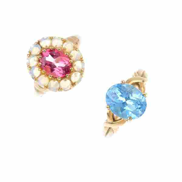 Four 9ct gold gem-set rings. To include a pink topaz