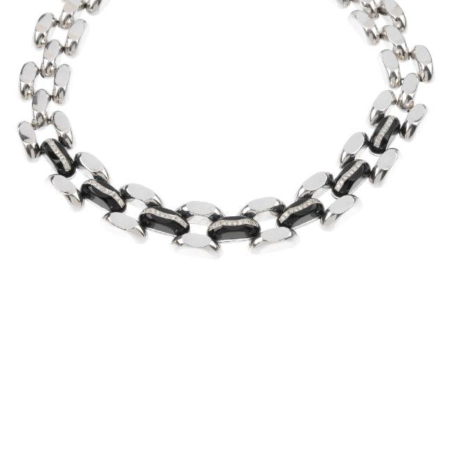 A diamond and onyx necklace. Designed as a series of
