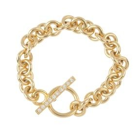 An 18ct gold bracelet, with diamond T-bar clasp. The
