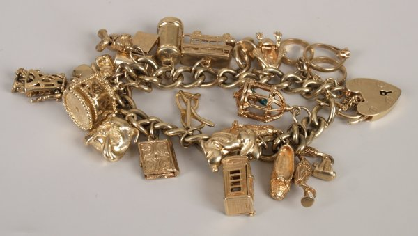 1: 9ct yellow gold twisted curb link bracelet and padlo