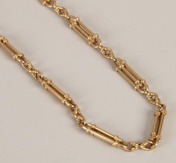 6: 15ct gold fancy 'trombone' link longuard chain.  Len