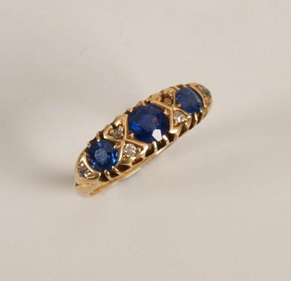 12: 18ct gold sapphire and diamond seven stone boat sha
