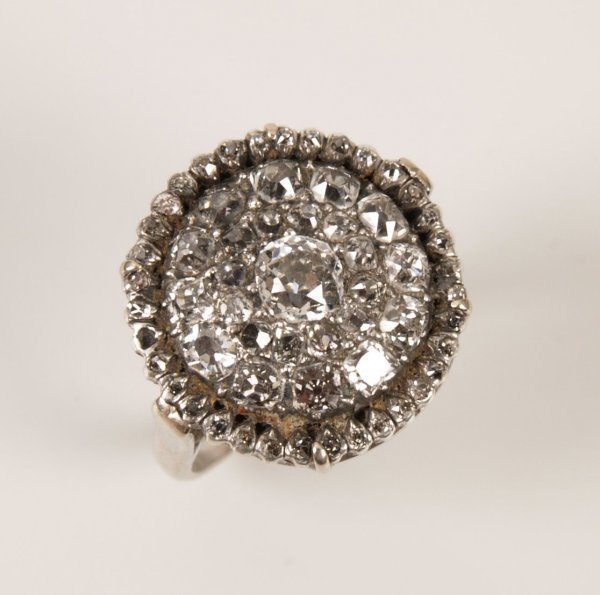 13: Late 18th century diamond cluster ring with central
