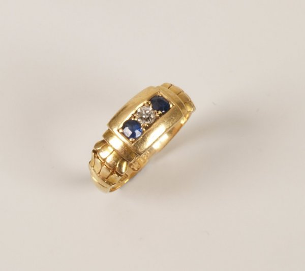 22: 18ct diamond and sapphire band ring with central di