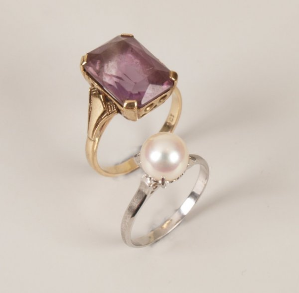 24: Two rings to include a 14ct white gold pearl ring w