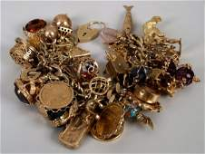 57: 9ct gold curb link charm bracelet with fifty charms