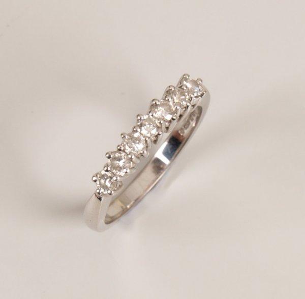 146: 18ct white gold seven stone diamond half eternity