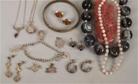 A small collection of silver and costume jewellery