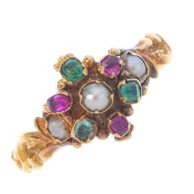 A mid Victorian gold gem-set dress ring. The split
