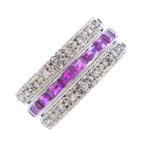 A ruby, sapphire and diamond ring. The calibre-cut ruby