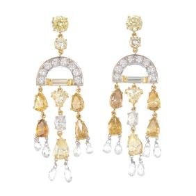 A pair of diamond and coloured diamond earrings. Each