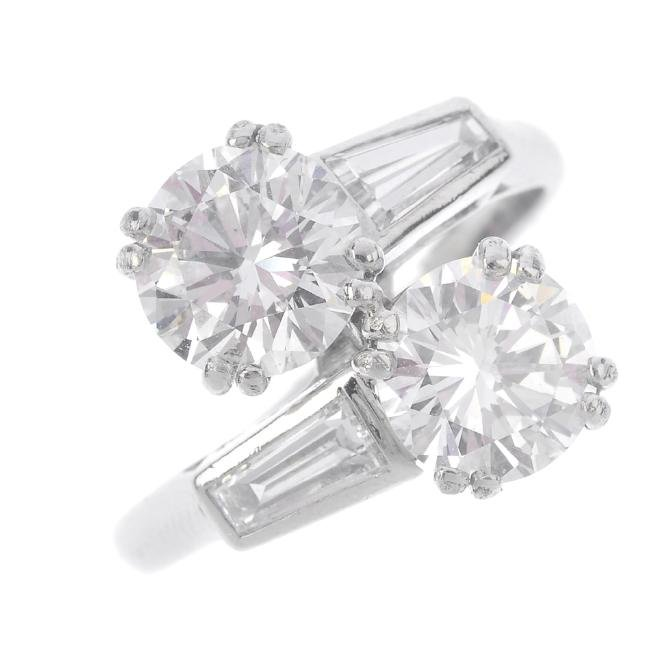 CHAUMET - a diamond crossover ring. The brilliant-cut