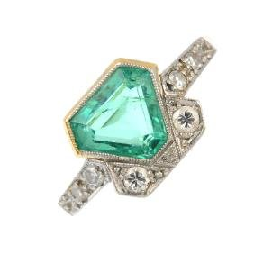 An Art Deco platinum and gold, emerald and diamond