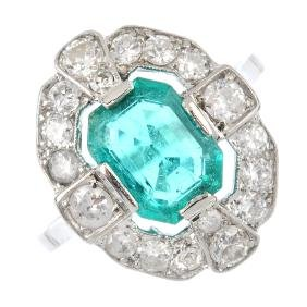 An Art Deco platinum, emerald and diamond ring. The