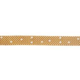 An 18ct gold diamond bracelet. Designed as a series of