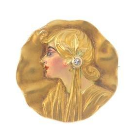 An Art Nouveau gold enamel and diamond brooch. Of