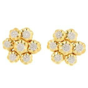 A pair of diamond floral earrings. Each designed as a
