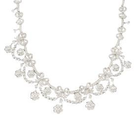 A diamond necklace. Designed as a graduated series of