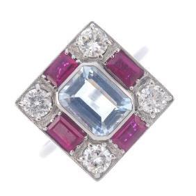 An aquamarine, ruby and diamond dress ring. The