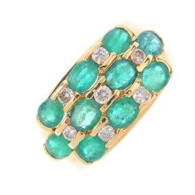 An emerald and diamond dress ring. Comprising three