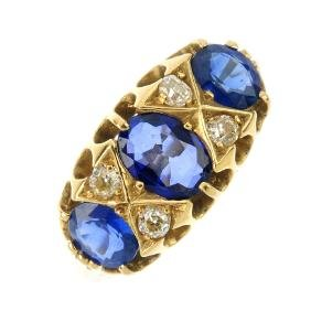 A sapphire three-stone ring. The graduated oval-shape