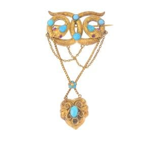 A late Victorian gold turquoise brooch. Comprising twin