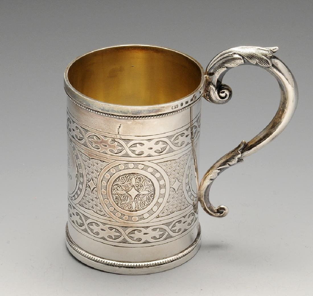 A Victorian silver mug, the straight sided body
