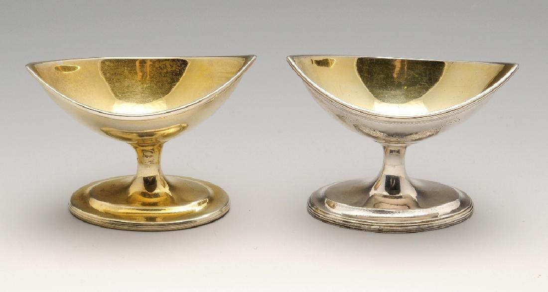 Two similar George III Irish silver pedestal salts of