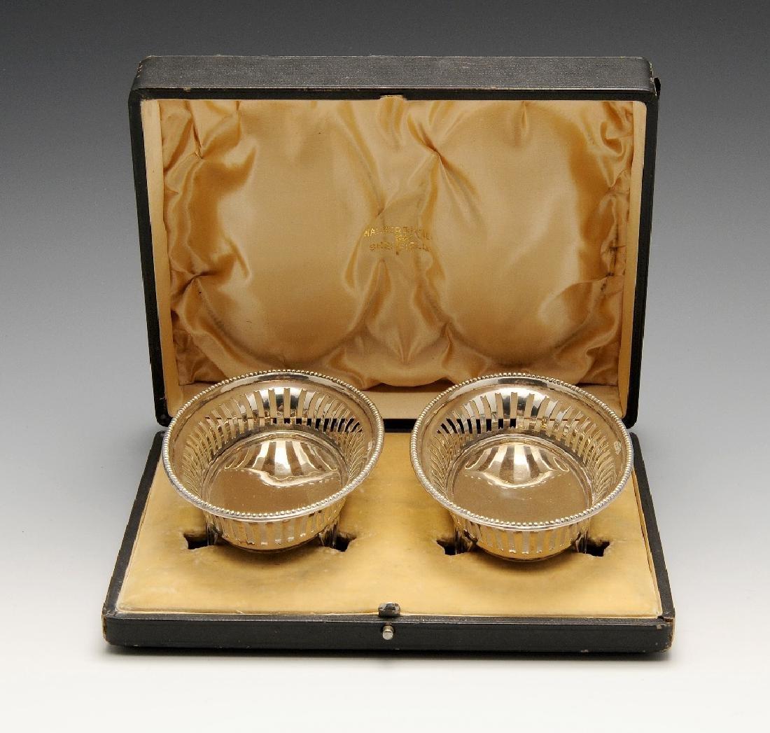 A cased pair of early twentieth century silver bonbon