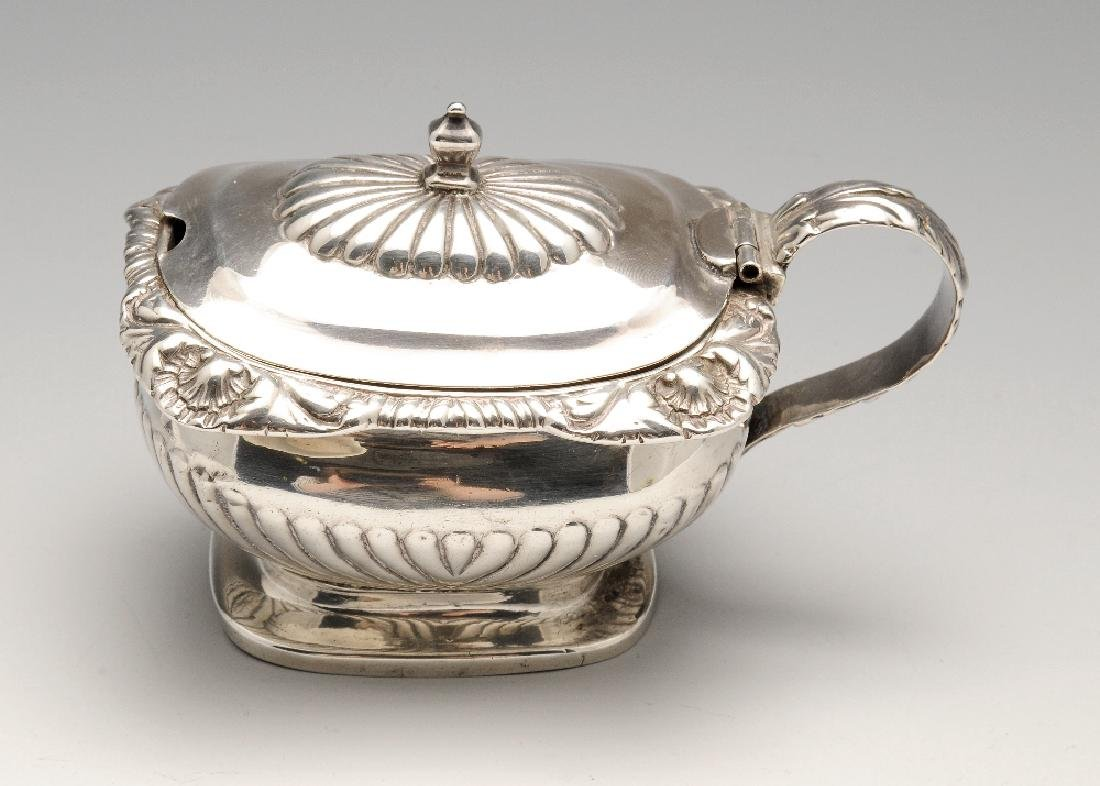 A late George III silver mustard pot, the bellied form