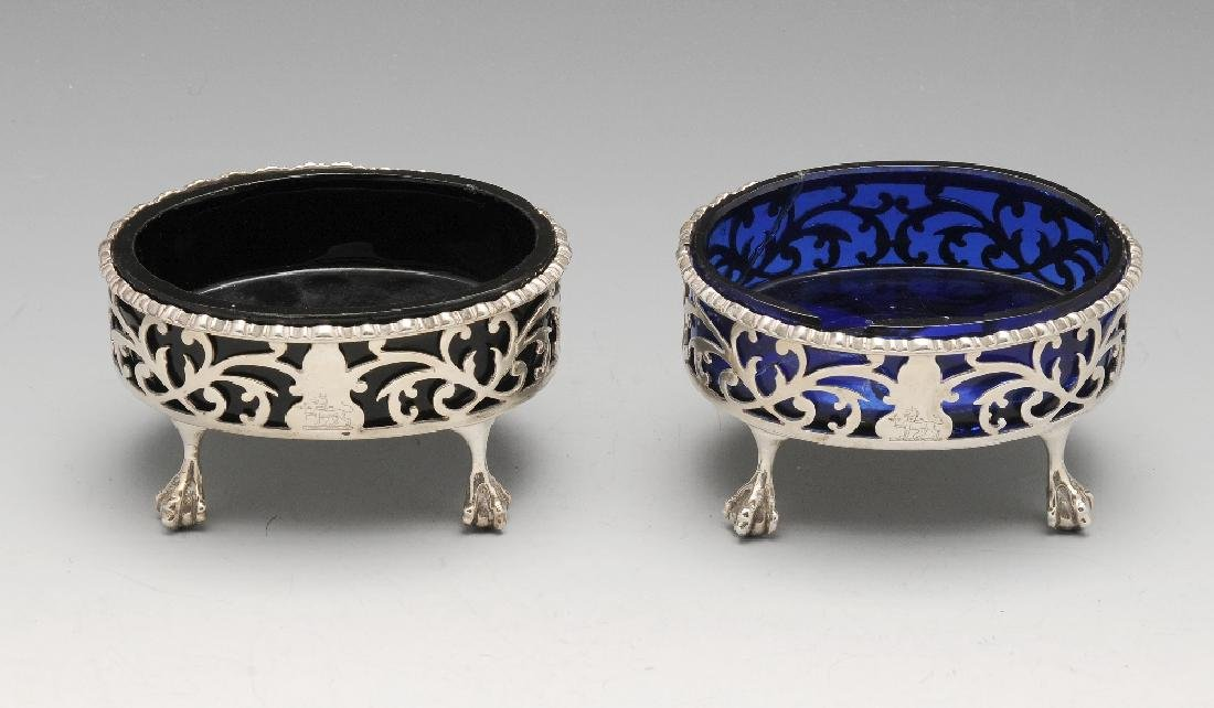A pair of George III open salts, the oval scroll