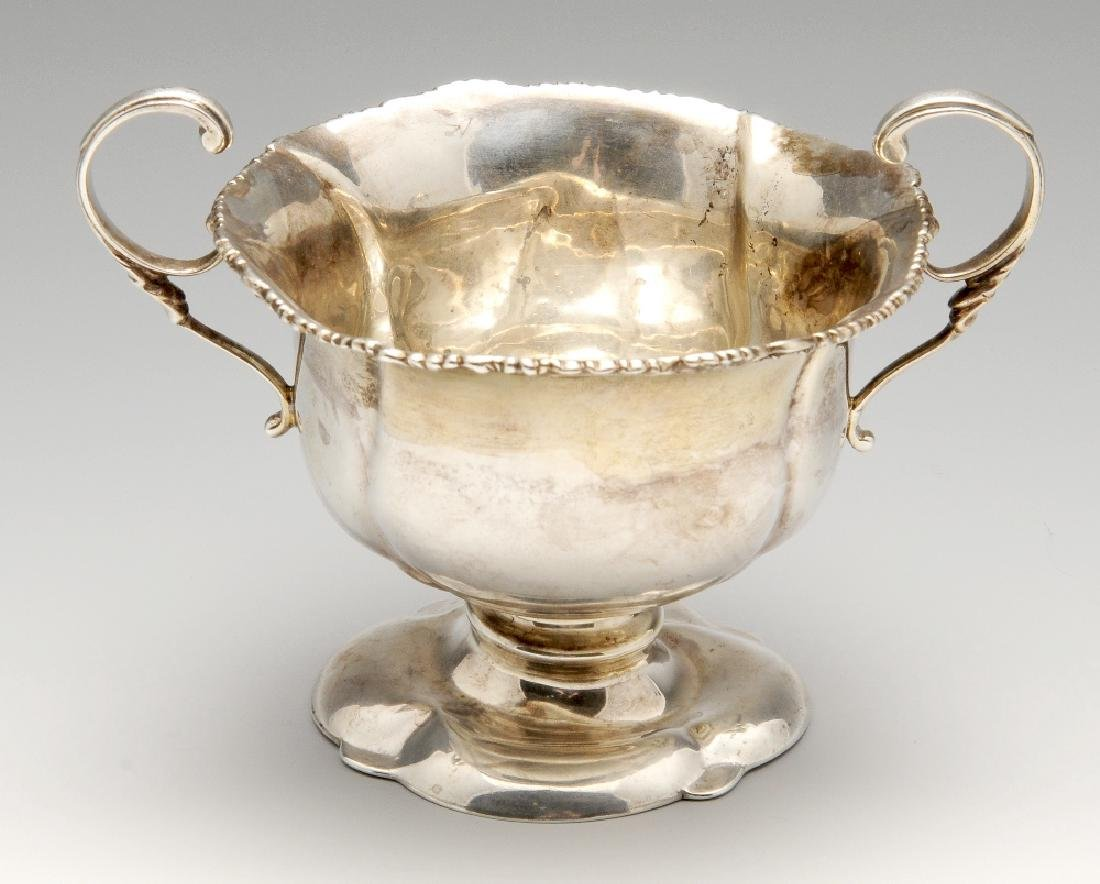 An Edwardian silver pedestal bowl, the softly fluted