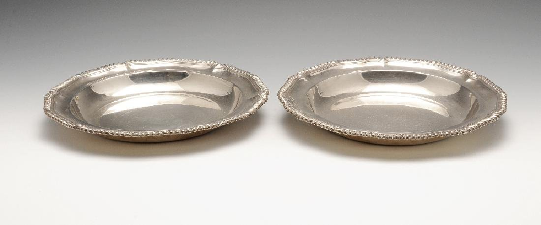 A pair of early Victorian silver entree dishes, each of