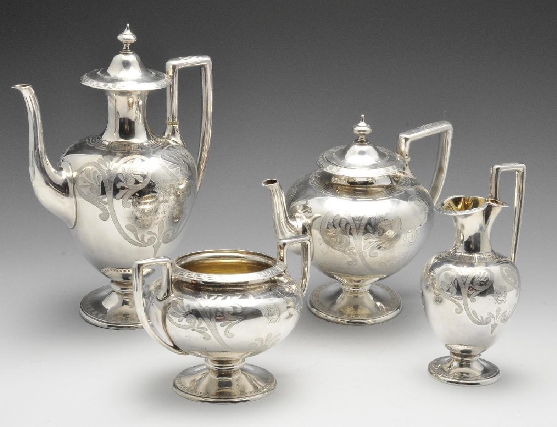 A Victorian four piece silver tea service, the