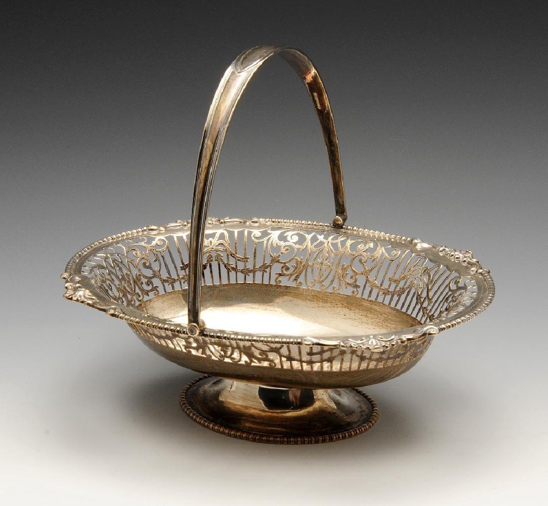 An early twentieth century silver swing-handled basket,