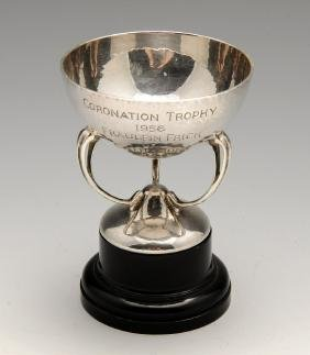A small silver trophy cup of Art Nouveau style, the