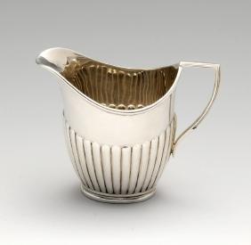 An early twentieth century small silver cream jug of