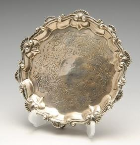 A George III silver waiter, of circular form with