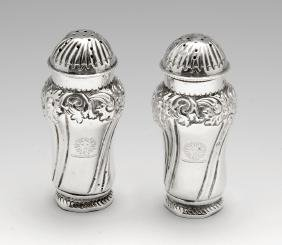 A pair of late Victorian silver pepper pots, each with