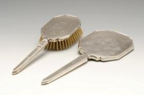 A 1940's silver mounted hand mirror and hair brush,