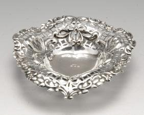 A late Victorian silver trinket dish, the shallow heart