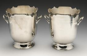 A modern pair of silver plated wine coolers with