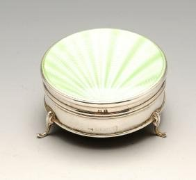 A 1930's silver jewellery or trinket box of circular