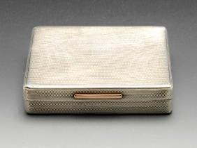 A 1930's silver cigarette or snuff box, the oblong form