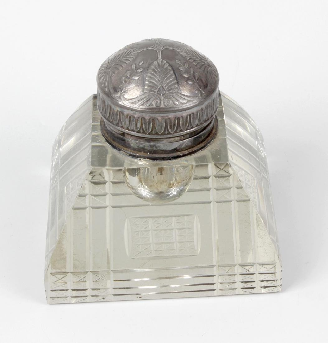 An impressive early 20th century heavy glass inkwell,