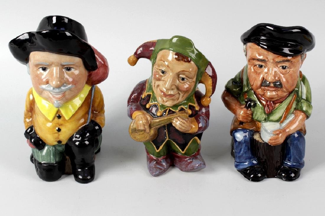 A large group of Artone character jugs and teapots. To