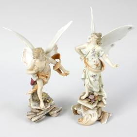A pair of German porcelain figures of Cupid and Psyche.