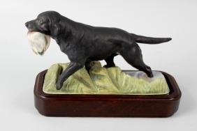 A Royal Worcester porcelain model of a Labrador. Matt