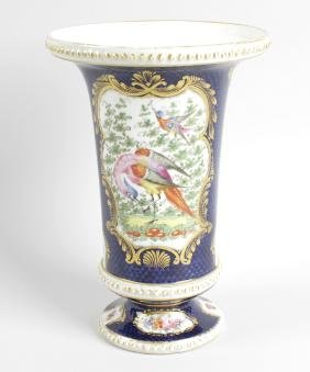 An early 19th century porcelain vase, the body of