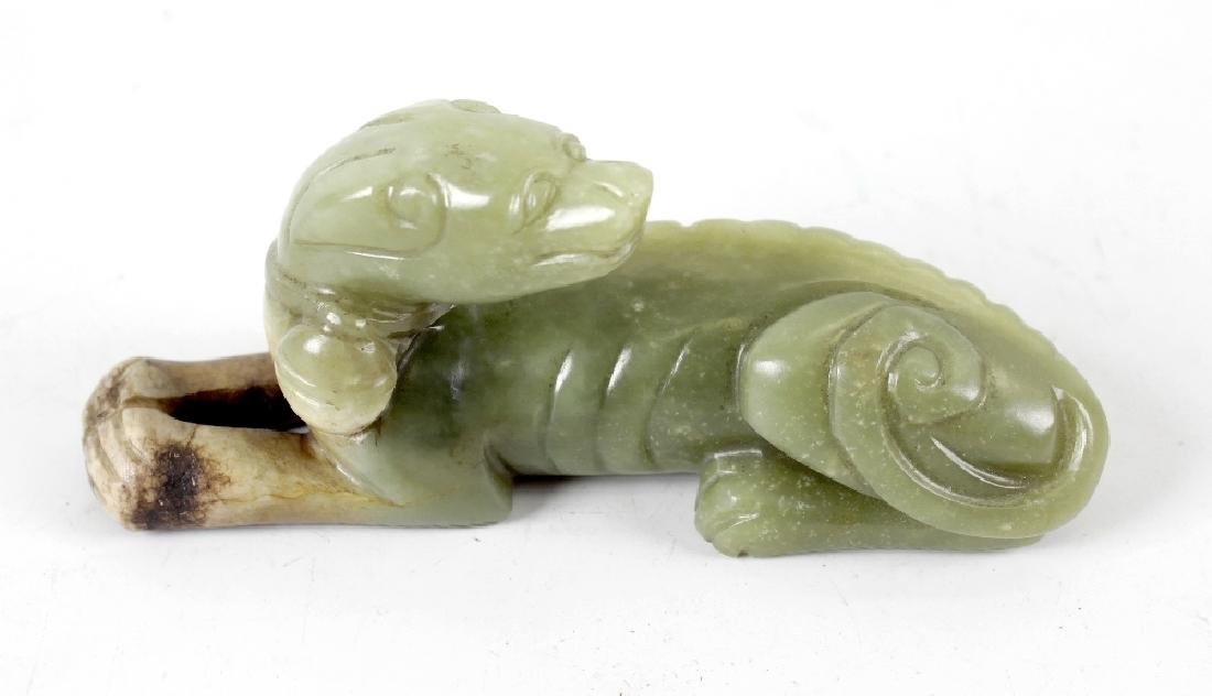 A Chinese yellow and russet jade figure, modelled as a